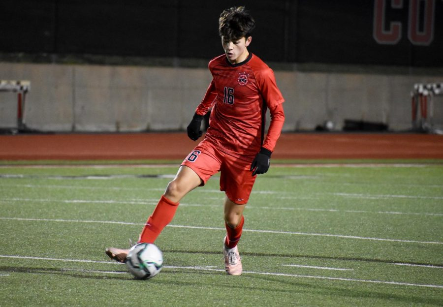 Coppell freshman midfielder Preston Taylor makes a run downfield on Dec. 12 against Frisco Heritage at Buddy Echols Field. Taylor is one of 13 Cowboys selected for a District 6-6A award.