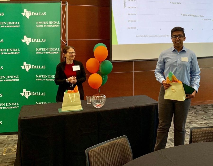 Coppell High School senior Bikal Sharma receives an award for being the fourth best trader during the Top Trader Competition at the University of Texas at Dallas last year. Sharma will attend Stanford University after high school and pursue a medical degree.