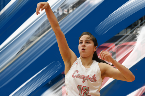 Coppell senior guard Anika Herron shoots a 3-pointer against Irving on Jan. 11 in the CHS Arena. Herron committed to play basketball at UD for the 2020-21 school year.