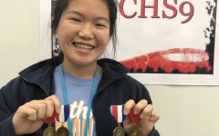 CHS9 student Ashley Zhang displays her VASE medals at CHS9. Zhang is one of four Coppell students whose artworks received a gold seal at the state VASE competition.