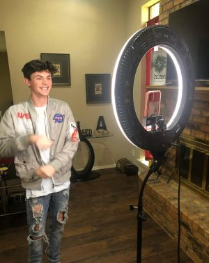 Coppell High School senior Trevor Williams makes TikToks in front of his ring light in his living room on May 5. Williams started making TikToks as a way to eliminate his boredom and in the process found his love for content creation.