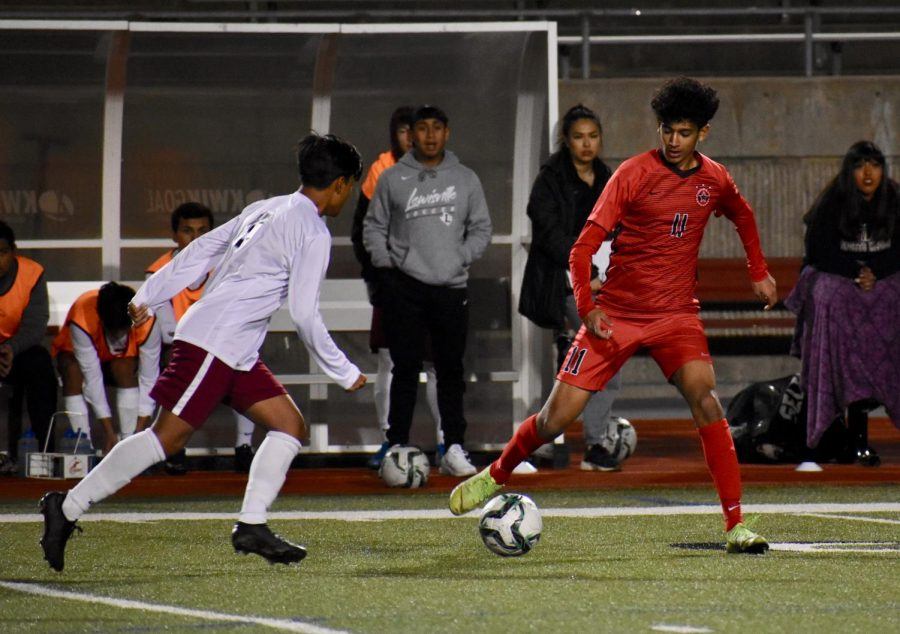 Coppell senior midfielder Adam Saif steals from Irving Nimitz on Feb. 18 at Buddy Echols Field. Saif is one of 13 Cowboys selected for a District 6-6A award.