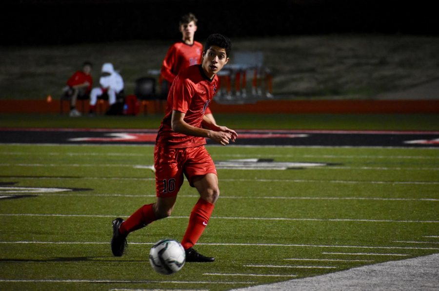 Coppell senior midfielder Caleb Razo looks to pass on Feb. 7 against Irving Nimitz at Buddy Echols Field. Razo is one of 13 Cowboys selected for a District 6-6A award.