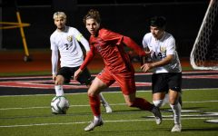 Coppell senior forward Sebastian Blaas avoids the grasp of Irving MacArthur to make a pass on Feb. 7. Blaas is one of 13 Cowboys to be selected for a District 6-6A award.