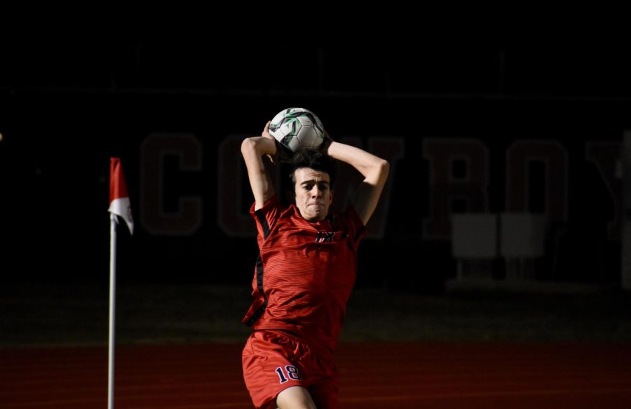 Coppell junior defender Daniel Nelson takes a throw-in on Feb. 7 against Irving MacArthur at Buddy Echols Field. Nelson is one of 13 Cowboys selected for a District 6-6A award.