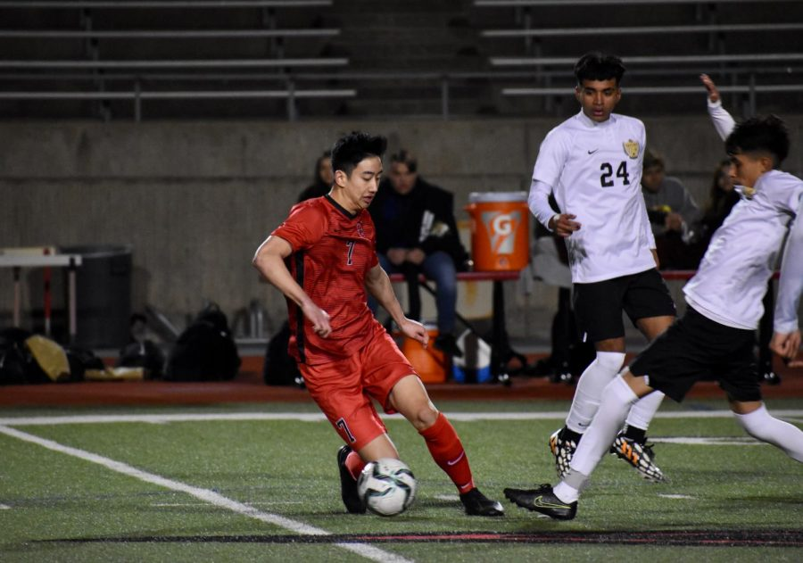 Coppell senior midfielder Ben Wang avoids a steal on Feb. 7 against Irving MacArthur at Buddy Echols Field. Wang is one of 13 Cowboys selected for a District 6-6A award.