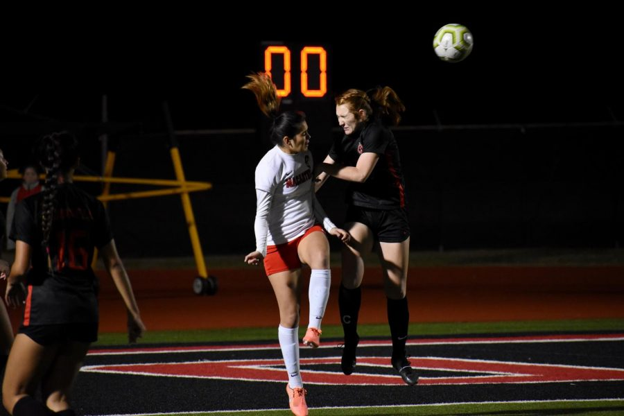 Coppell junior defender Addison Martin duels for an aerial header on Jan. 24 against Irving MacArthur at Buddy Echols Field. Martin is one of 12 Cowgirls awarded a District 6-6A award.