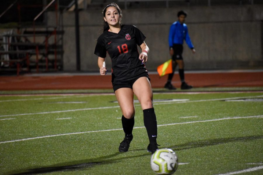Coppell senior midfielder Montse Lomeli looks to gain possession on Jan. 24 against Irving MacArthur at Buddy Echols Field. Lomeli is one of 12 Cowgirls awarded a District 6-6A award.