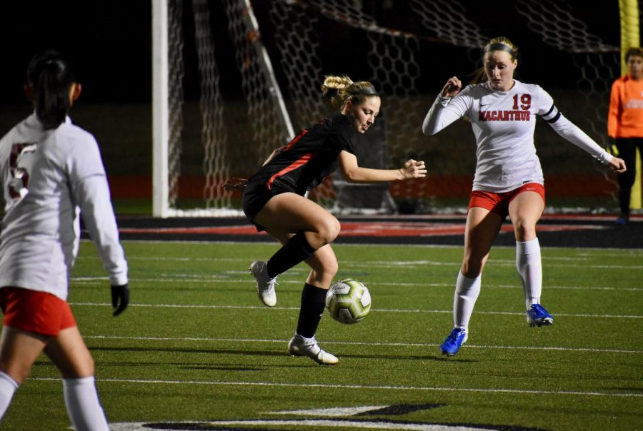 Coppell junior defender Emma Hubert receives from the air against Irving Macarthur on Jan. 24 at Buddy Echols Field. Hubert is one of 12 Cowgirls awarded a District 6-6A award.