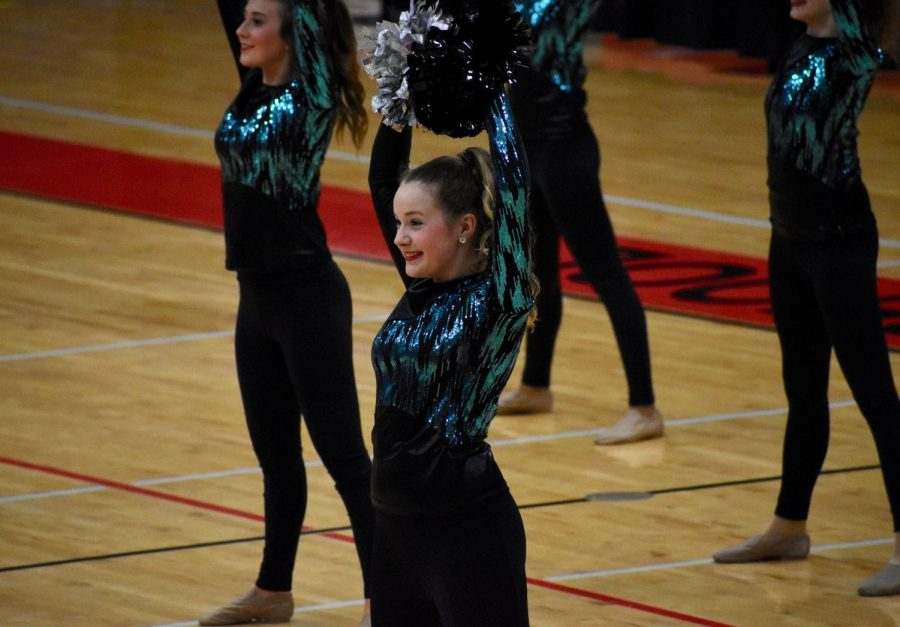 Freshman Grace Cates performs in the Laretties showoff on Feb. 12 in the CHS Arena. Cates balances both Silver Stars and technical theatre at CHS9.