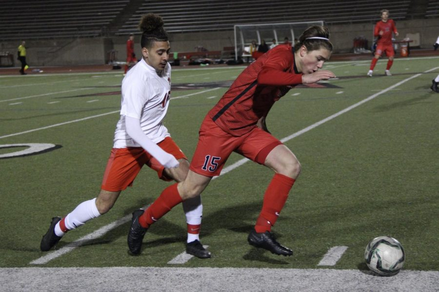 Coppell freshman forward Nic Radicic dodges Irving Nimitz on Feb. 18 at Buddy Echols Field. Radicic is one of 13 Cowboys selected for a District 6-6A award.