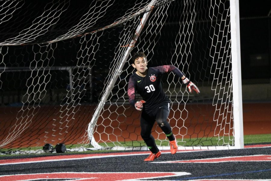 Coppell sophomore goalkeeper Arath Valdez runs to block on Jan. 31 against Lewisvillle at Buddy Echols Field. Valdez is one of 13 Cowboys selected for a District 6-6A award.
