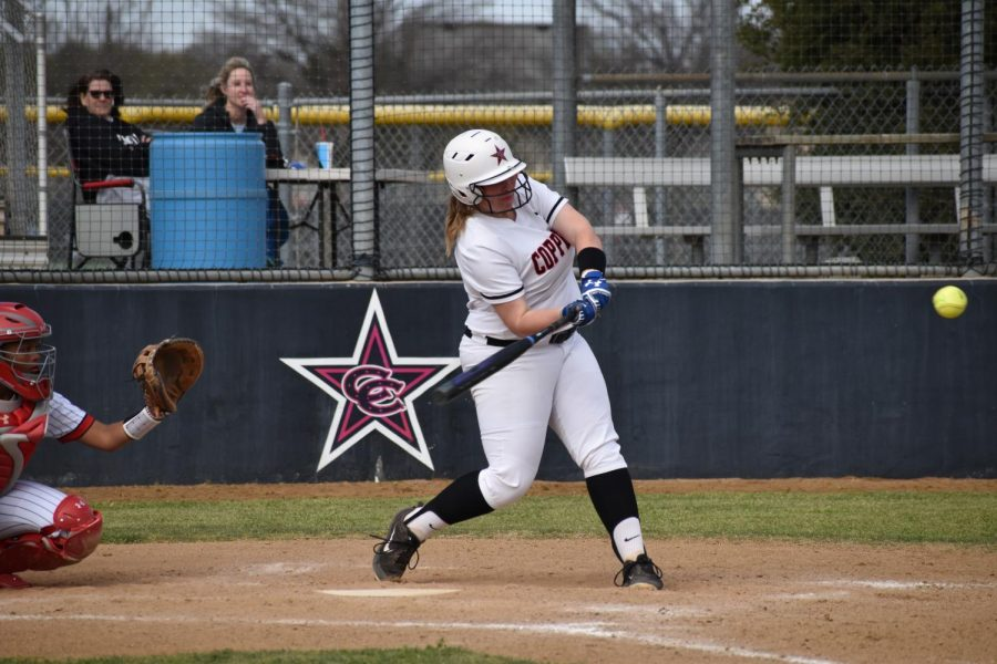 Coppell junior pitcher Michaella Baker swings against Cedar Hill on March 7 at the Coppell ISD Softball Complex. Baker verbally committed to Odessa College on April 8 and hopes to pursue teaching and coaching.