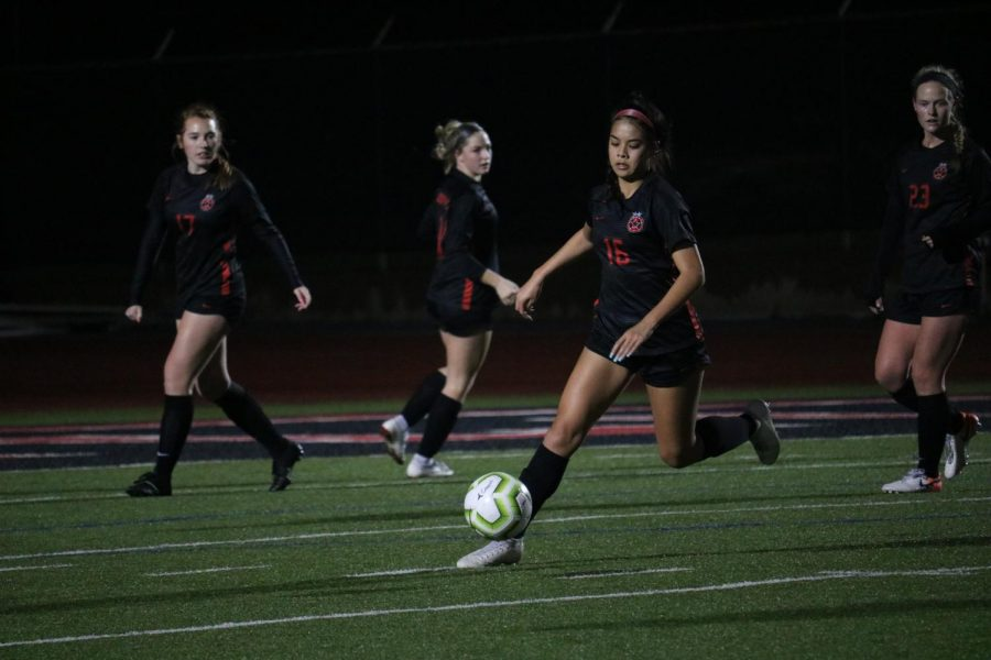 Coppell junior defender Chloe Phan makes a run down field on Feb. 11 against Flower Mound at Buddy Echols Field. Phan is one of 12 Cowgirls awarded a District 6-6A award.