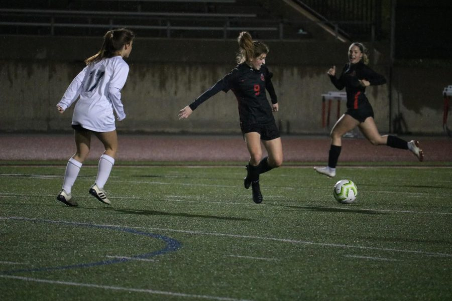 Coppell junior midfielder Ellie Stewart battles Flower Mound for possession on Feb. 11 at Buddy Echols Field. Stewart is one of 12 Cowgirls awarded a District 6-6A award.