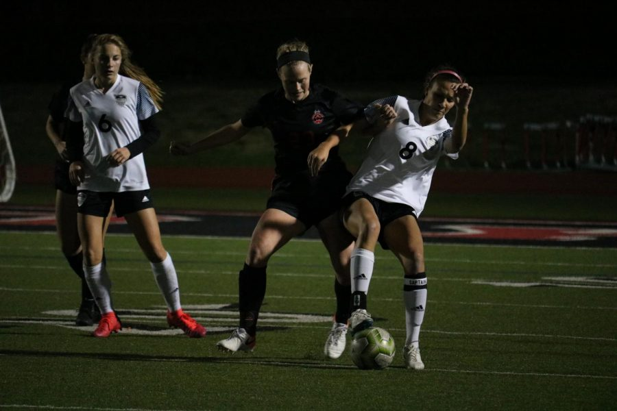 Coppell sophomore midfielder/defender Bailey Peek looks to steal from Hebron on Feb. 25 at Buddy Echols Field. Peek is one of 12 Cowgirls awarded a District 6-6A award.