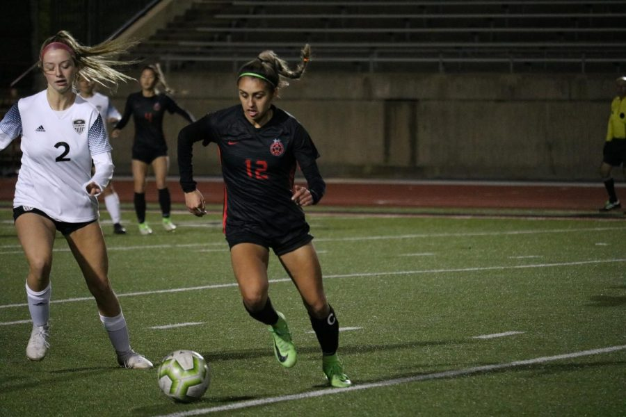 Coppell junior midfielder Jojo Alonzo races for possession on Jan. 24 against Irving MacArthur at Buddy Echols Field. Alonzo is one of 12 Cowgirls awarded a District 6-6A award.