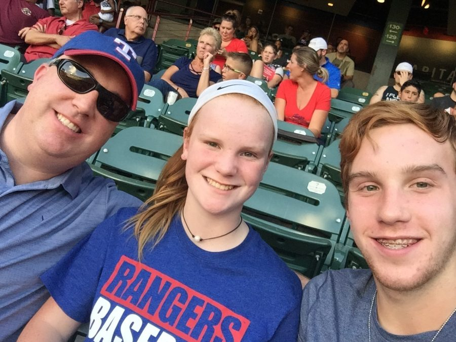 The Sidekick adviser Chase Wofford and his children Caroline and son John, attend the Texas Rangers vs. Seattle Mariners game on July 30 at Globe Life Park in Arlington, marking their last time to see the Rangers play in the stadium. Like many Dallas-Fort Worth sports fans, the Wofford family was excited about games in the new air-conditioned Globe Life Field this season before sports were put on hold due to COVID-19. Photo courtesy Chase Wofford
