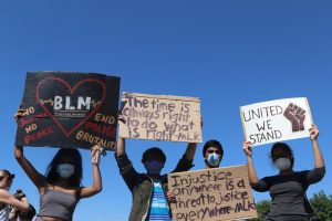 Coppell protesters stand against racism by supporting the Black Lives Matter movement behind City Hall on Wednesday. The Coppell community rallied together to spread awareness about BLM and fighting racial injustice.