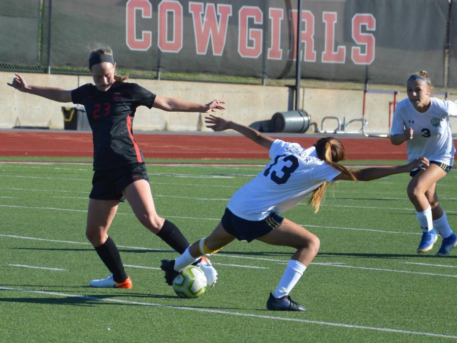 Coppell junior midfielder Bailey Peek challenges a Little Elm midfielder during a scrimmage on Dec. 14 at Buddy Echols Field. Peek verbally committed to play Division I soccer at Rice on July 10.