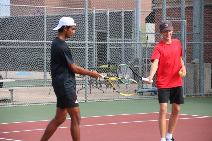 Coppell senior doubles partners Kunal Seetha and Austin Gregory celebrate with a racquet tap during practice on Friday at the CHS Tennis Center. Seetha and Gregory have just begun their last fall season as tennis partners.
