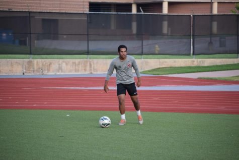 Coppell junior defender and The Sidekick co-sports editor Meer Mahfuz shoots during an individual practice on Aug. 25 at Buddy Echols Field. Mahfuz reflects on last year's season and explains how the process of returning to athletic play this season has impacted him.