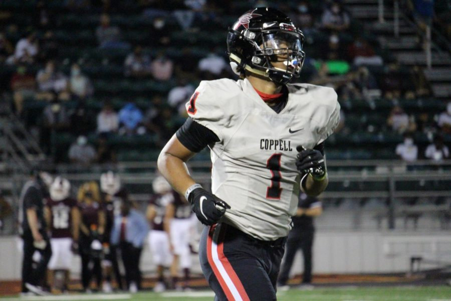 Coppell+senior+wide+receiver+KJ+Liggins+plays+in+his+first+game+with+the+Cowboys+since+sophomore+year+against+Mesquite+at+E.H.+Hanby+Stadium+on+Friday.+Liggins+returned+to+Coppell+High+School+after+attending+Denton+Guyer+for+a+year.