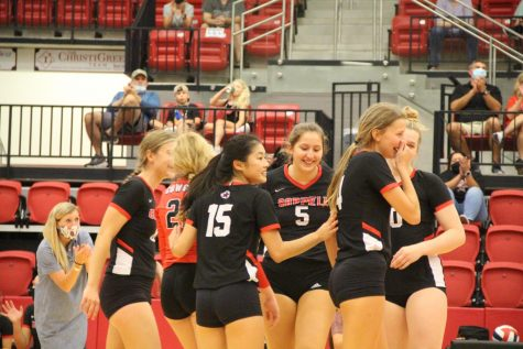 The Cowgirls embrace after winning a tough point against Sachse on Sept. 18 at the CHS Arena. Coppell plays Prosper Rock Hill, Rockwall and McKinney Boyd this Friday and Saturday.