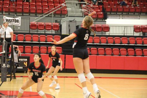 Coppell junior outside hitter Haley Holz spikes against Keller Central at the Coppell High School Arena on Friday. The Cowgirls won three of four preseason matches this weekend.