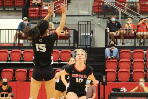 Coppell senior setter Mari Taira sets for sophomore outside hitter Reagan Engler against Keller Central at the CHS Arena on Friday. Tomorrow, the Cowgirls face McKinney Boyd at 5 p.m. and Weatherford at 8 p.m. in the CHS Arena.