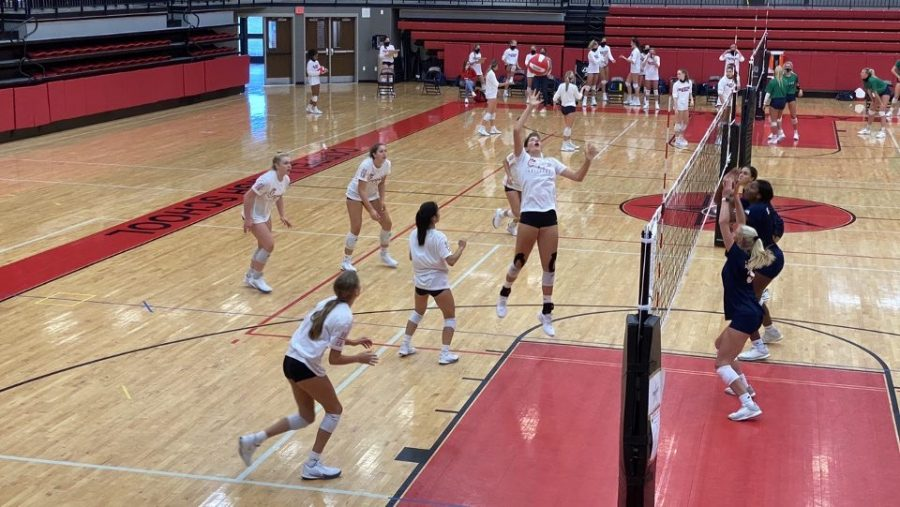 Coppell+junior+middle+hitter+Alessandra+Clent+spikes+the+ball+against+Eaton+on+Sept.+11+at+the+CHS+Arena.+The+Cowgirls+played+the+first+scrimmages+of+the+season+against+Sachse%2C+Eaton%2C+Grapevine+and+Richardson+this+weekend.+