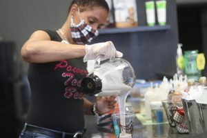 Co-owner Jeniece Paige makes the Cookies N' Cream protein shake at the counter of Fit Hub in Coppell on Sept. 10. Paige, with help from friend and co-owner Thalissa Williams, opened Fit Hub in September 2018 to help people live a healthier lifestyle.
