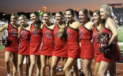 The Coppell cheer team supports the Coppell football team against Irving MacArthur on Nov. 27, 2019 at Buddy Echols Field. This year's cheer team has a smaller number of underclassmen and a much larger number of upperclassmen.