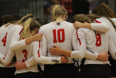 The Coppell volleyball team huddles in the Coppell High School Arena on Friday. Coppell defeated Prosper Rock Hill and Rockwall 3-0, losing to McKinney North 3-1.