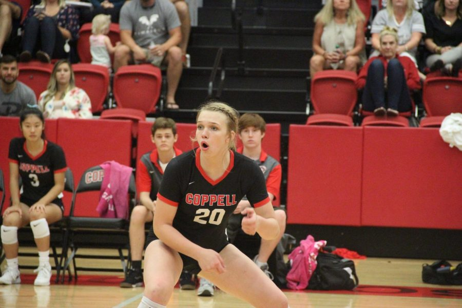 Coppell sophomore outside hitter Reagan Engler stands ready to receive as she watches her teammates against Grapevine on Sept. 10, 2019 in the CHS Arena. Coppell will take on Sachse, Grapevine and Eaton tomorrow at 5 p.m. in the CHS Arena for the first scrimmage of the season.