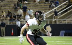 Coppell senior defensive back Will Kraus drops in coverage against Highland Park at Highlander Stadium on Oct. 9. Coppell lost to Highland Park, 42-36.