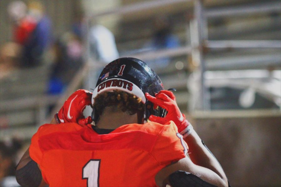 Coppell senior wide receiver/defensive back KJ Liggins removes his helmet on Friday at Buddy Echols Field. Coppell defeated Sachse, 42-35.
