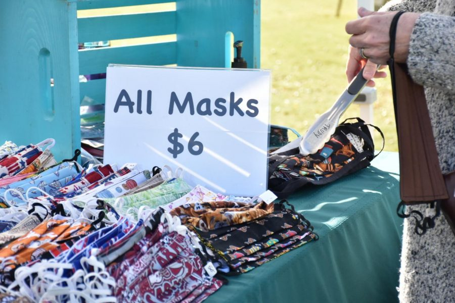 Coppell Senior Center group Knit Wits creates and distributes masks at the Coppell Farmers Market on Oct. 17. Knit Wits has sold masks every month since the COVID-19 pandemic began in the United States to ensure others' safety.