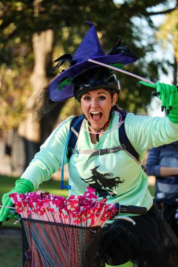 Coppell resident Katy Willey rides on her bike with candy during the Witches Ride on Thursday. The bike ride was held throughout various neighborhoods in Coppell from 5-7 p.m. where 11 Coppell residents rode around on bikes throwing candy out for neighbors.