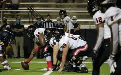 Coppell senior center Febechi Nwaiwu, senior offensive linemen Austin Darcy and sophomore offensive lineman Trevor Timmerman prepare for a play against Highland Park at Highlander Stadium on Oct. 9. Coppell lost to Highland Park, 42-36.