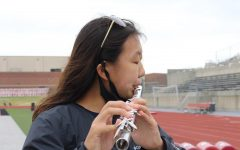 CHS9 freshman Lindsey Won practices her solo piece at Buddy Echols Field during seventh period on Oct. 15. Won is the only freshman in Coppell High School's Wind Symphony Band.