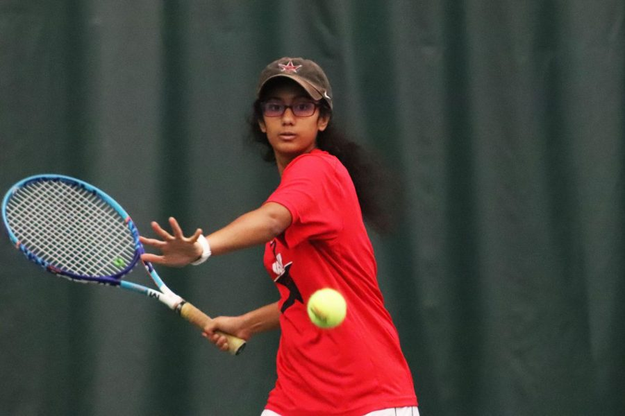 Coppell senior co-captain Rishita Uppuluri approaches a forehand against Prosper on Monday night at T Bar M Racquet Club in Dallas. Coppell won 10-2, clenching the Class 6A Region I bi-district title and advancing to area later this week.