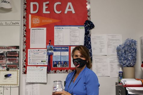 CHS9 Principles of Business, Marketing and Finance and Business Information Management teacher Kim Porter shows pride in Distributive Education Clubs of America (DECA) in her classroom on Thursday. Porter was selected as the CHS9 September Teacher Spotlight.