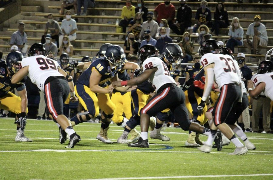 Coppell senior defensive lineman Fernando Pando, junior defensive lineman Simi Ncube-Socks and senior linebacker Marcelo Estrada charge Highland Park on Oct. 9 at Highlander Stadium. The Sidekick executive editor-in-chief Sally Parampottil believes linemen are essential to football but often go underappreciated.