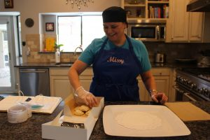 Coppell parent and Missy's Cottage Bakery owner Michelle Zenici packages cookies at her house on Oct. 24. Zenici established Missy's Cottage Bakery on July 3 after a change in the Texas Cottage Food Law that allows bakers to produce and sell goods from home. (Precious Onalaja)