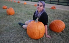 The Sidekick executive editorial page editor Camila Villarreal enjoys the fall season at the Flower Mound Pumpkin Patch on Monday. Due to COVID-19, fall has felt gloomy, but Villarreal emphasizes the importance of keeping the fall spirit alive.
