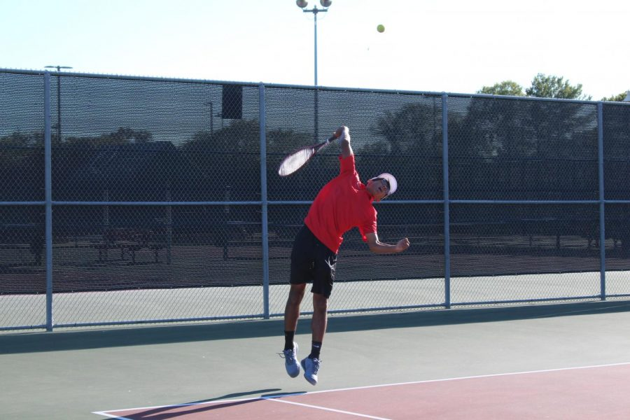 Coppell junior Atharva Nijasure takes an overhead against Marcus last Tuesday at the CHS Tennis Center. Coppell takes on Lewisville at 4 p.m. tomorrow at the CHS Tennis Center.