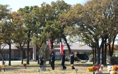 The Coppell Police Department carries the United States and Texas flags at Rolling Oaks Memorial Center on Nov. 11. Coppell residents gathered at the memorial center to honor those who served in the armed forces on Veterans Day.