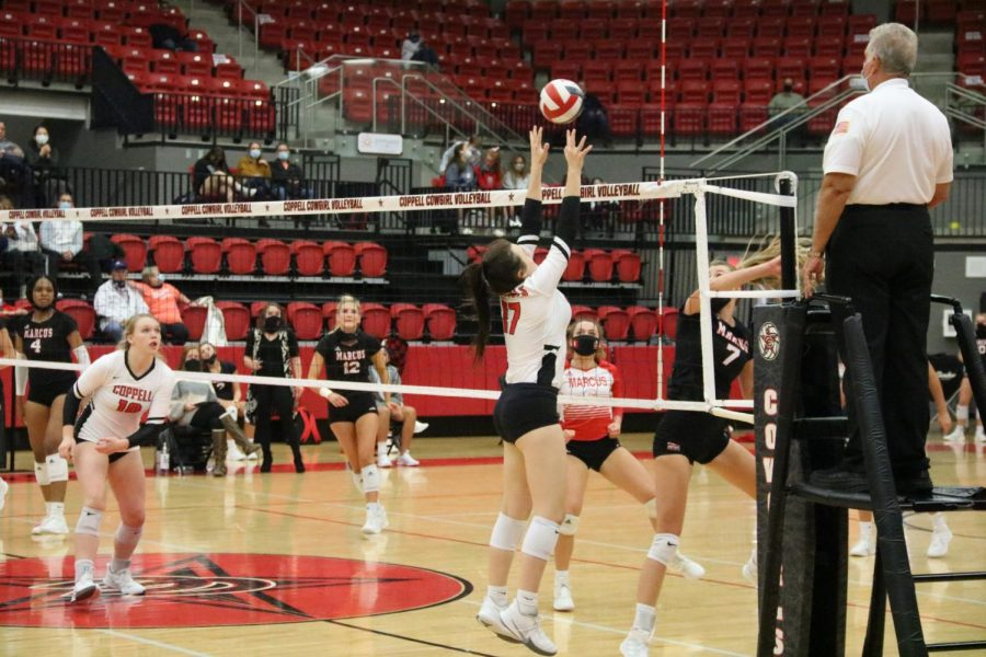 Coppell sophomore setter Taylor Young blocks against Marcus on Tuesday at the CHS Arena. Marcus beat Coppell 25-16, 25-13, 22-25, 25-12.