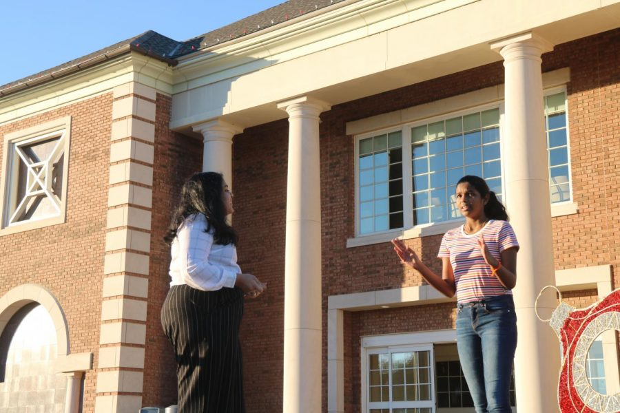 CHS9 students Akshita Krishnan and Nidhi Ilanthalaivan, pictured behind Coppell Town Center Plaza on Nov. 30, were named finalists for congressional debate at a virtual debate tournament held at the University of North Texas on Oct. 27-28. Outside of debate, Krishnan enjoys writing poetry and Illanthalaivan enjoys painting.